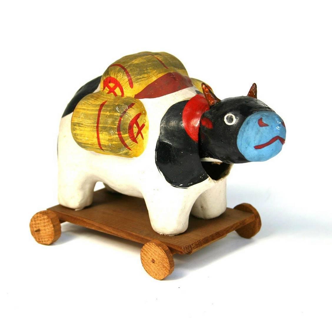 פרה עם צרורות אורז, קנאזווה, שנות ה־30